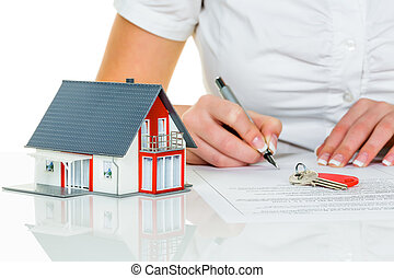 woman signs agreement for house - a woman signs a purchase ...