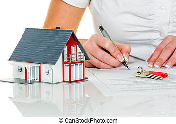 woman signs purchase agreement for house - a woman signs a...