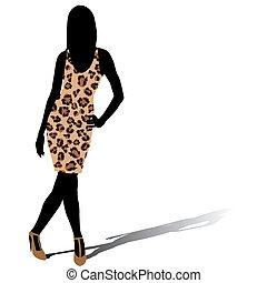 Woman silhouette in leopard skin dress