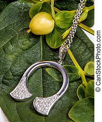 woman silver pendant necklace with white swarovski stones