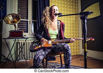 Woman singing in studio - Blonde woman singing in studio