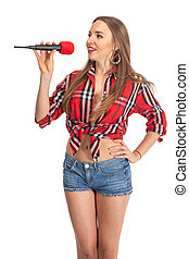 Woman singing karaoke with microphone