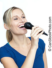 Woman singing on a microphone