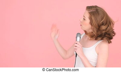Woman Singing Or Talking Into Mic
