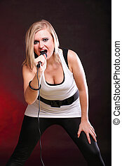 woman singing rock song microphone