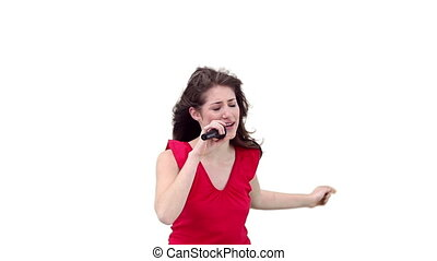 Woman singing while holding a microphone