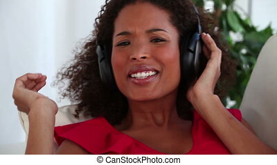 Woman singing while listening to music