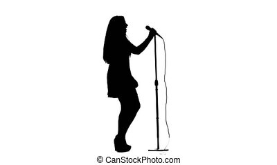 Woman sings incendiary songs into the microphone. White background. Silhouette