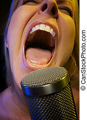 Woman Sings with Passion - Woman with Microphone Sings with ...