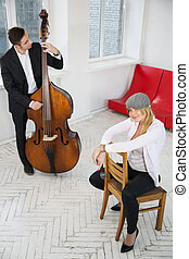 Woman sit backwards on chair and man