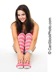 Woman sit in pink striped socks smiling look at camera isolated on white