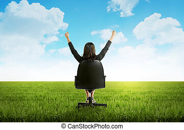 Woman Sit On Chair On Green Grass
