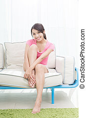 woman sit on sofa