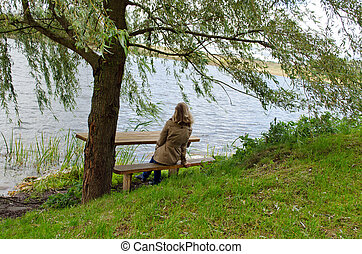 woman sit wooden bench willow tree admire lake