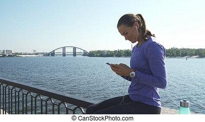Woman sits and talk via phone