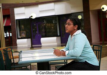 Woman Sits at Cafe - Woman sits and waits at a cafe ...
