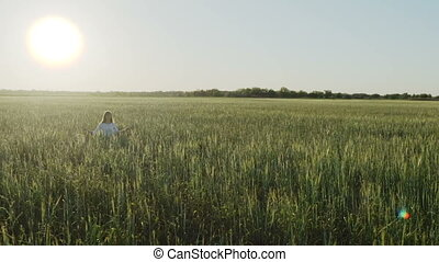 Woman sits in field in lotus position zen gesturing