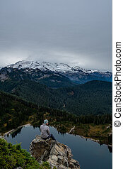 Woman Sits on Rock Ledge on Tolmie Peak