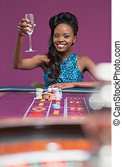Woman sitting at a roulette table
