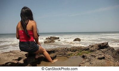 Woman Sitting At Beach