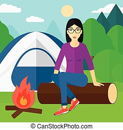 Woman sitting at camp.