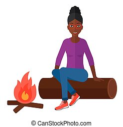 Woman sitting at camp. - An african-american woman sitting...