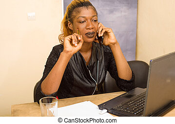 woman sitting at the desk and talking on the phone