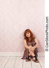 Woman sitting at the floor