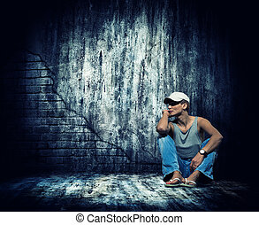 Woman sitting by the concrete wall
