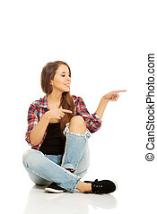 Woman sitting cross-legged
