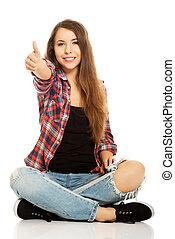 Woman sitting cross-legged