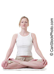 Woman sitting crossed legged in yoga position on white