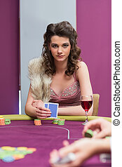 Woman sitting holding cards