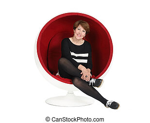 Woman sitting in a chair on a white background