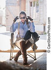 Woman sitting in a chair.