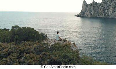 Woman sitting in a lotus pose
