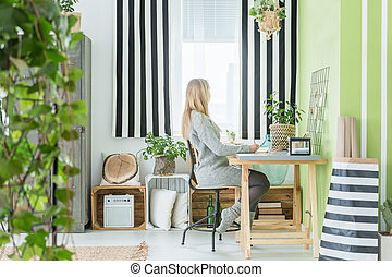 Woman sitting in a room