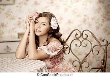Woman sitting in a room with a vintage interior
