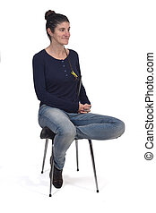 woman sitting in a vintage chair isolated on white