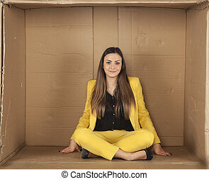 woman sitting in an empty office