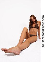 Woman sitting in bikini