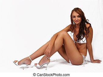 Woman sitting in bikini with shoes on