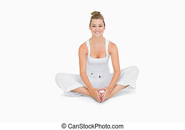 Woman sitting in bound angle yoga pose