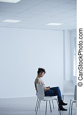 Woman sitting in bright room