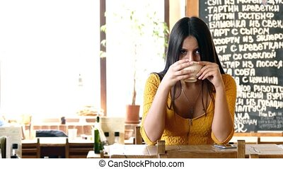 Woman sitting in cafe