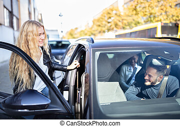 Woman Sitting In Car With Friends