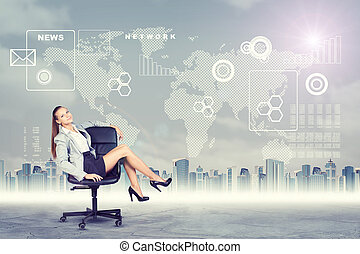 Woman sitting in chair and looking at camera