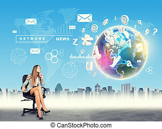 Woman sitting in chair and looking at Earth