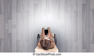 Woman sitting in chair in an empty office