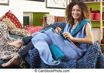 Woman Sitting In Chair Knitting